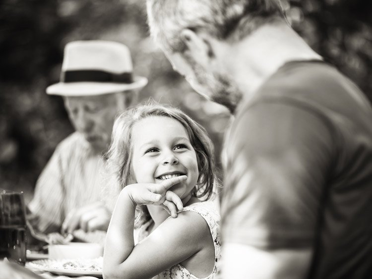 Little girl smiling at father